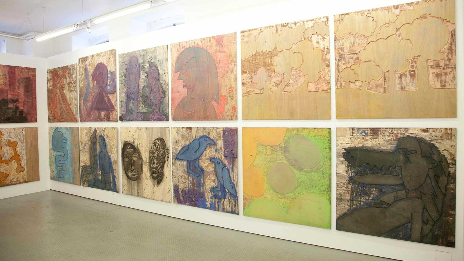 2 rows of paintings and etchings from Cedar Lewisohn's exhibition.