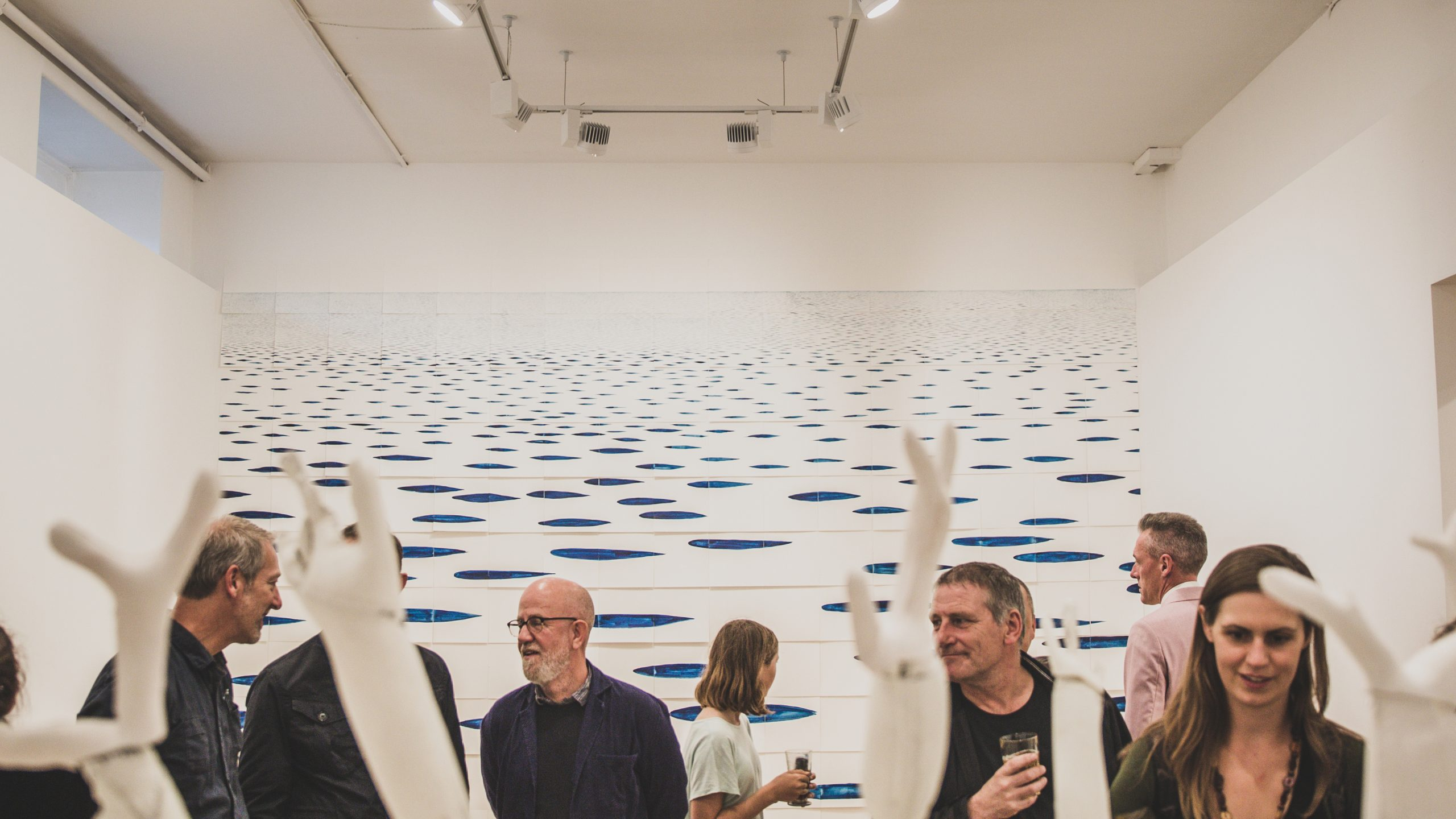 A photograph of a private view gallery event