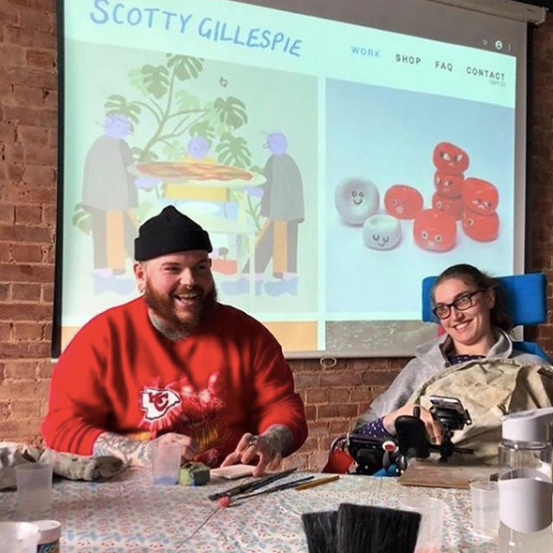 A Freefall Plus workshop with artist Scotty creating ceramic artwork with a participant in a wheelchair