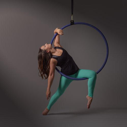 A woman holds a hoop on a pole