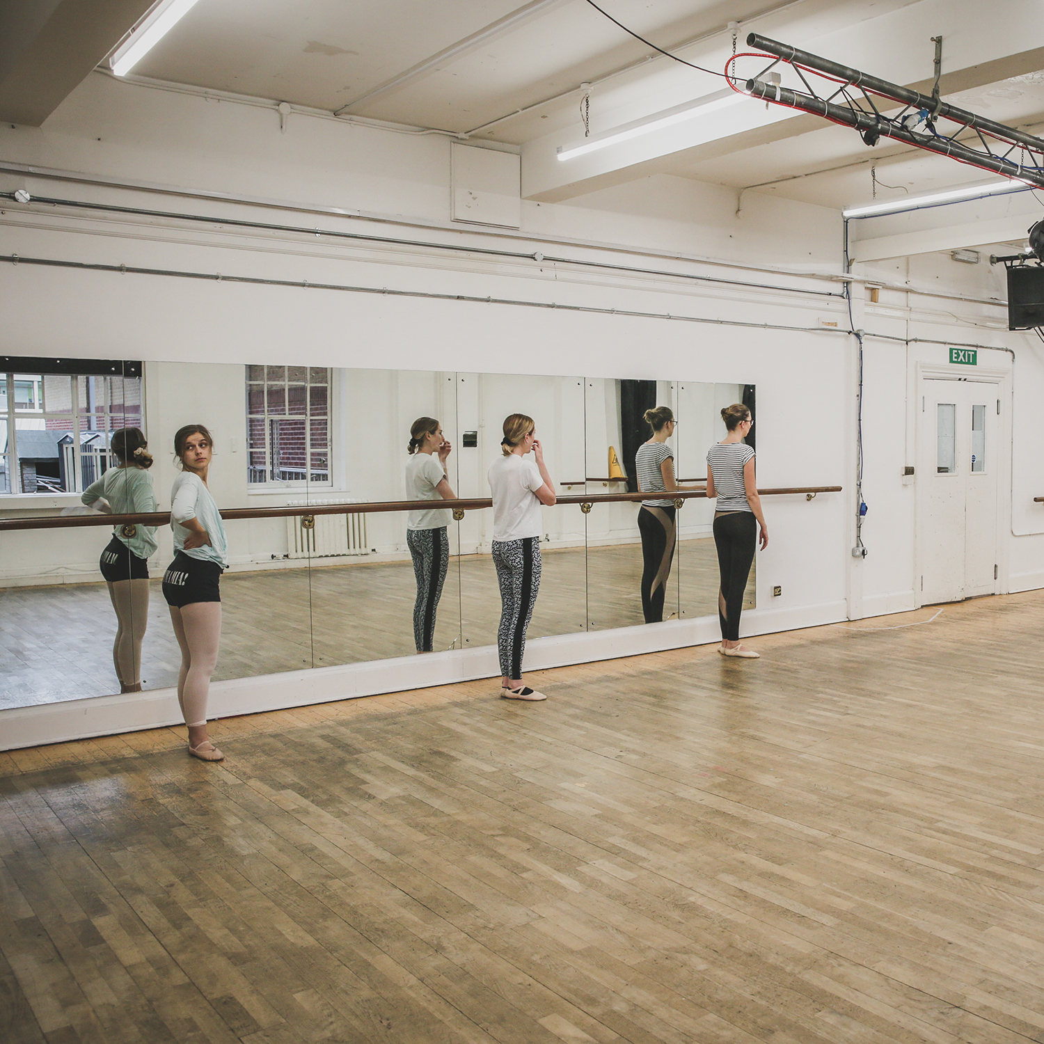 Three ladies taking part in a dance lesson.
