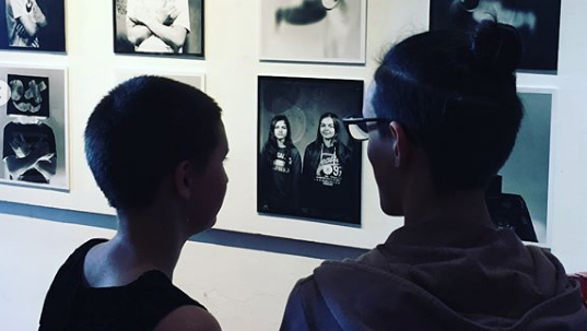 Two people looking at a photography exhibition