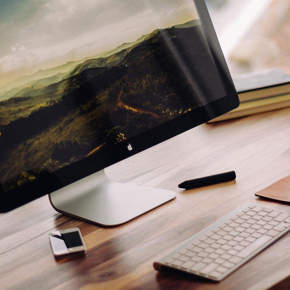 A desktop mac with a keyboard.