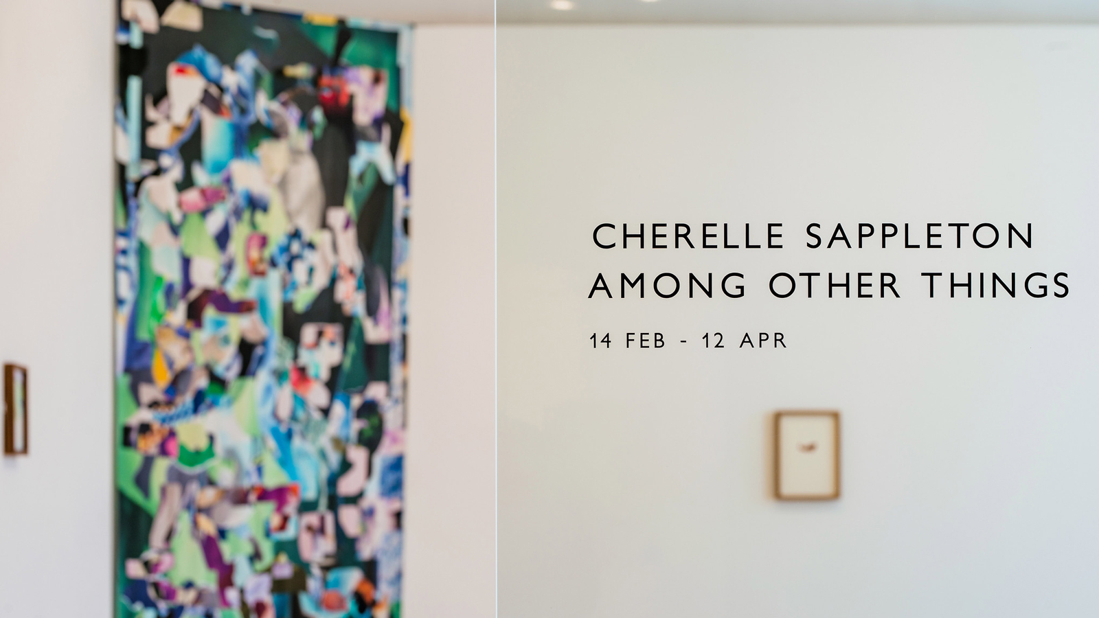 The view through the gallery doors into an exhibition of artworks by Cherelle Sappleton