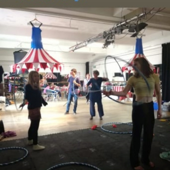 People play with hula-hoops at a circus skills workshop