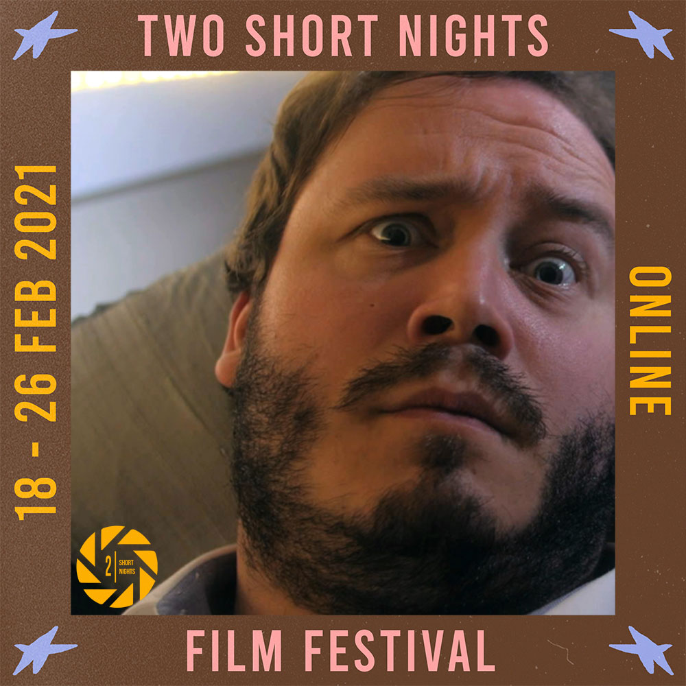 A man lies on sofa looking perplexed. The image is framed by a border with the words that read Two Short Nights Online Film Festival