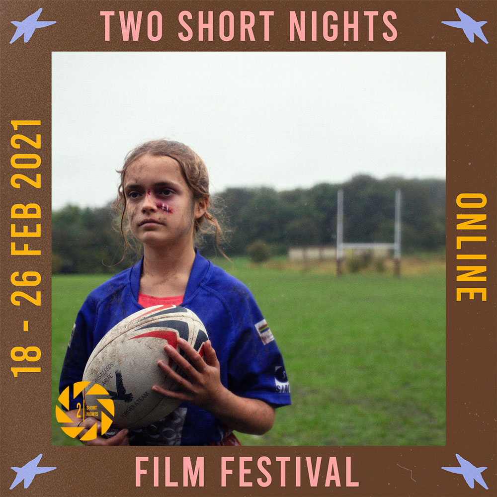 A young girl with cuts on her face stands on a rugby pitch in a blue rugby shirt holding a rugby ball. The image is framed by a border with the words that read Two Short Nights Online Film Festival