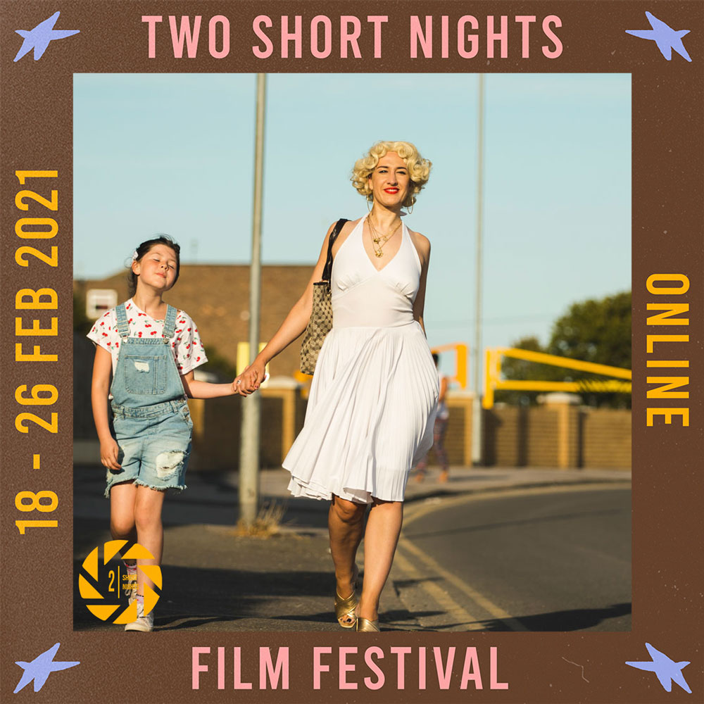A smiling woman in a fifties style white dress holds the hand of a young girl in denim dungarees as they walk along the street. The image is framed by a border with the words that read Two Short Nights Online Film Festival