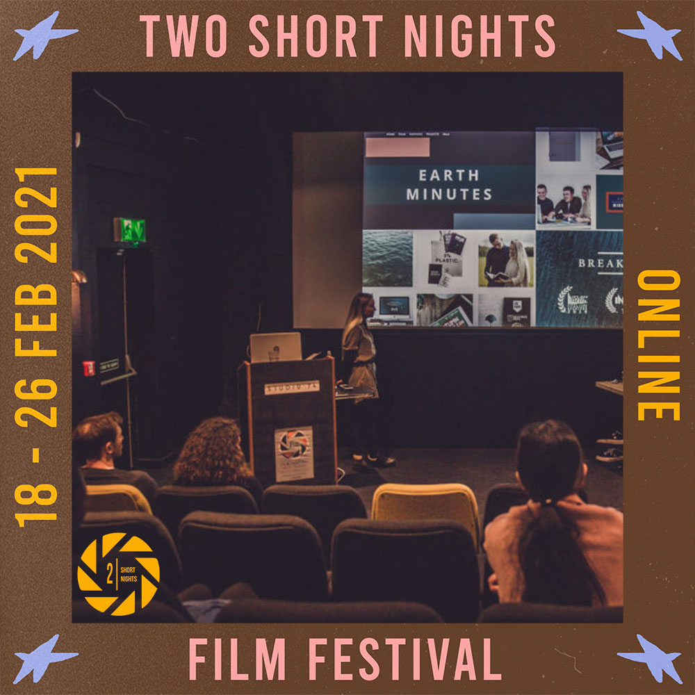 A woman gives a presentation in studio 74 cinema standing in front of a lectern. The image is framed by a border with the words that read Two Short Nights Online Film Festival