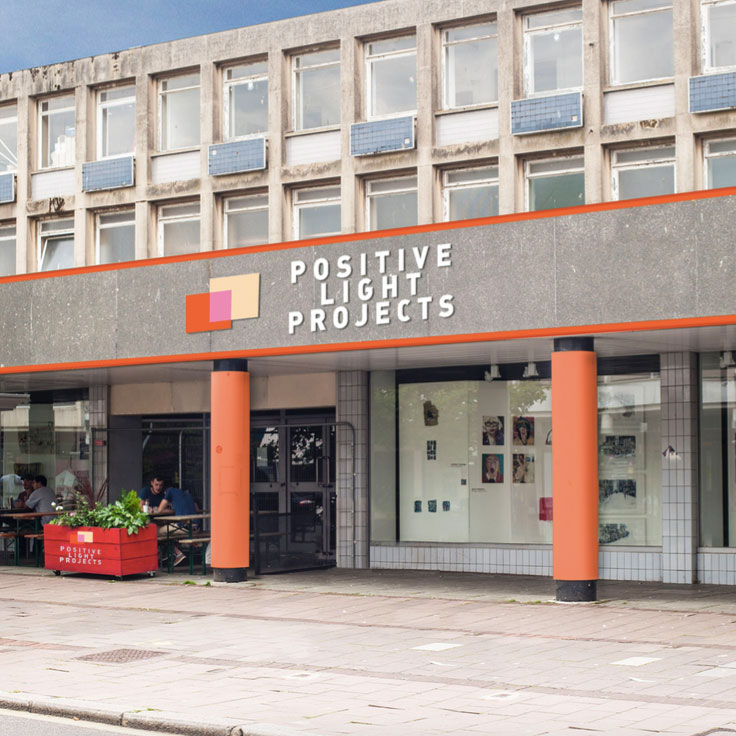 An image of a building on Sidwell Street with the words Positive Lights Project above the door.