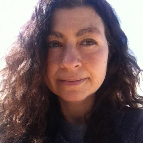Close up photograph of filmmaker Barbara Santi who has long wavy brown hair