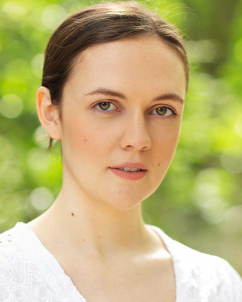 A portrait photograph of Zoe Blos.