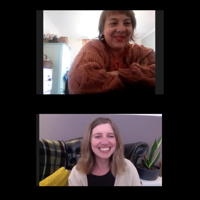 A screenshot of a zoom conversation between two women, smiling to each other.