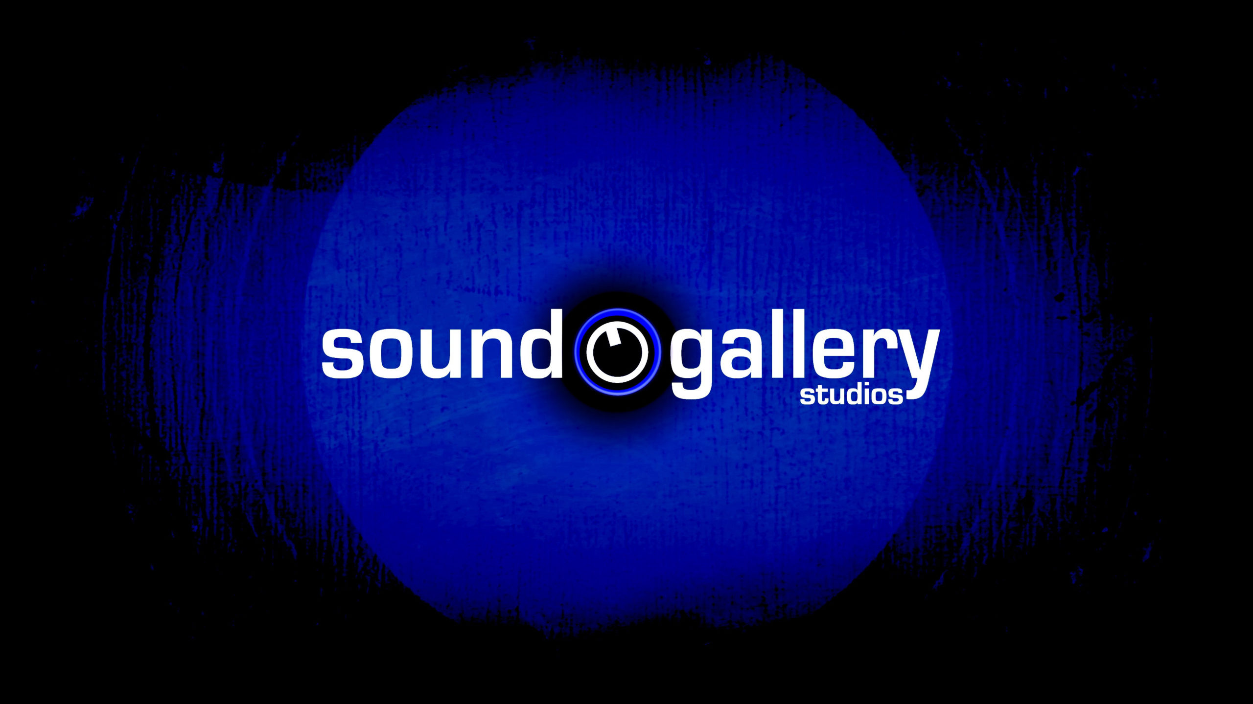 Sound Gallery's logo. A black background with a blue circle. White text on top reads Sound Gallery Studios. In the middle of the image is a volume control.